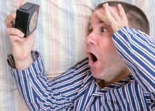 Homem surpreendido na cama Fotografia de Stock