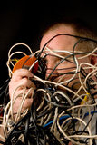 Homem Tangled nos fios imagens de stock royalty free