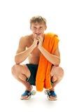 Homem Tanned com toalha fotografia de stock
