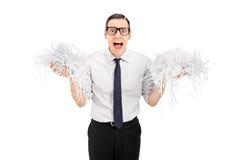 Homem terrificado que guarda um grupo do papel shredded Imagens de Stock Royalty Free
