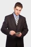 Homem triste com dinheiro Foto de Stock