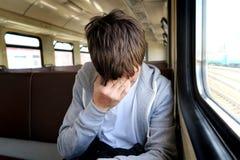 Homem triste no trem Fotografia de Stock