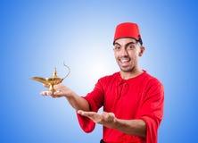 Homem turco com a lâmpada no branco Fotos de Stock Royalty Free