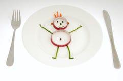 Homem vegetal no prato Imagens de Stock Royalty Free