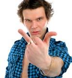 Homem virado que dá o dedo médio Fotos de Stock