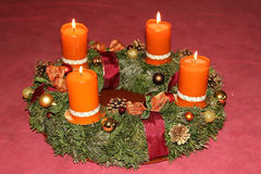 Homemade advent wreath with cinnamon candles. Homemade advent wreath with burning cinnamon candles and red ribbon Royalty Free Stock Image
