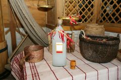 Homemade alcohol. Slavic interior with a bottle of homemade alcohol Royalty Free Stock Photos
