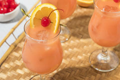 Homemade Alcoholic Hurricane Cocktail Drink. With Rum and Orange Juice royalty free stock images