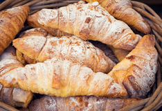 Homemade Almond Croissants in basket, food market display Royalty Free Stock Photography