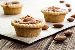 Homemade Almonds tart on wooden table background Royalty Free Stock Images