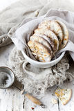Homemade alternative cookies on bowl on white wooden table with vintage strainer Stock Photos