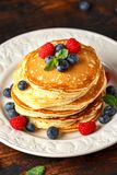 Homemade american blueberry, raspberries pancakes. Healthy morning breakfast. rustic style. stock photo