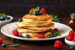Homemade american blueberry, raspberries pancakes. Healthy morning breakfast. rustic style. royalty free stock image