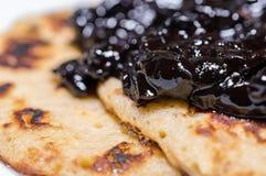 Homemade american sweet pancakes with cherry, fruit jam on a white napkin Stock Photo