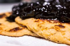Homemade american sweet pancakes with cherry, fruit jam on a white napkin Royalty Free Stock Photography