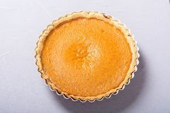 Homemade american traditional pumpkin pie Autumn food background royalty free stock image