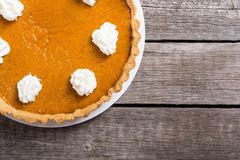 Homemade american traditional pumpkin pie Autumn food background royalty free stock photography