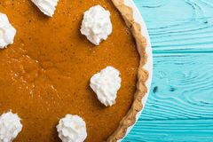 Homemade american traditional pumpkin pie Autumn food background stock photo