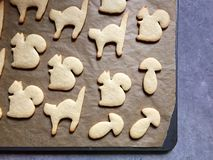 Homemade animal shaped sugar cookies baked, ready to decorate Stock Photography