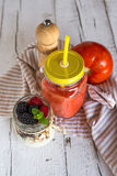 Homemade antioxidant smoothie summer fruits and cereals Stock Photos