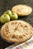 Homemade apple and blackberry pie. Homemade blackberry and apple pie. Made with homegrown apples and wild blackberries from England. The words apple & blackberry stock photo
