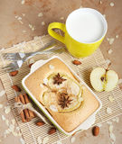 Homemade apple cake and yellow cup of milk royalty free stock photography