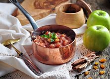 Homemade apple chutney with raisins, cinnamon, chili and other spices. Stock Photo