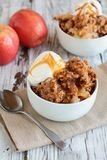 Homemade Apple Crisp or Crumble with Ice Cream and Caramel Sauce. Fresh hot homemade apple crisp or crumble with crunchy streusel topping topped with vanilla stock photos