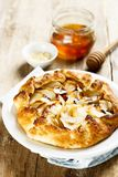 Apple galette with almond flakes and honey Royalty Free Stock Photo