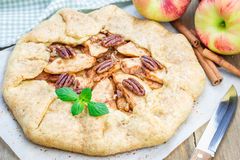Homemade apple galette with pecan nuts Royalty Free Stock Images