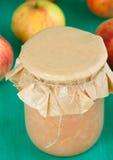 Homemade apple jam. Glass jar of apple jam and fresh apples Royalty Free Stock Image