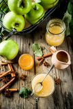 Homemade apple jam or sauce. With green apples and spices, wooden rustic background copy space royalty free stock image