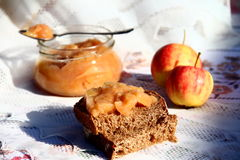 Apple Jam. Slice of dark bread with homemade apple jam Stock Photography