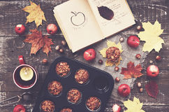 Homemade apple muffins and cup of tea with lemon, autumn mood Royalty Free Stock Images