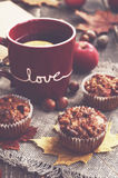 Homemade apple muffins and cup of tea with lemon, autumn mood Stock Image
