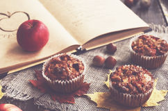 Homemade apple muffins and recipe book. Homemade apple muffins and cookbook, autumn mood stock photography