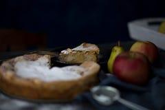 Homemade apple pie. Apple pie tart, ingredients - apples and cinnamon on rustic wooden background Stock Image
