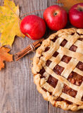 Homemade apple pie, apples and autumn leaves Stock Photography