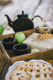 Homemade apple pie, apples and autumn leaves on the wooden table Stock Image