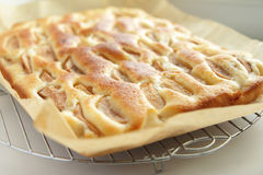Homemade apple pie in brown paper on a metal stand Stock Photos