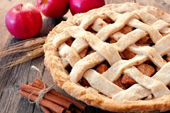 Homemade apple pie, close up scene. On a rustic wooden background Stock Photography