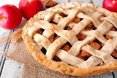 Homemade apple pie, close up scene on white wood. Fresh homemade apple pie, close up scene on a rustic white wood background Stock Image