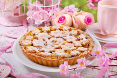 Homemade apple pie with cut out spring flowers Royalty Free Stock Images