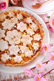 Homemade apple pie with cut out spring flowers Royalty Free Stock Image