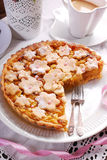 Homemade apple pie with cut out spring flowers Royalty Free Stock Photos