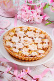 Homemade apple pie with cut out spring flowers Stock Images