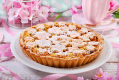 Homemade apple pie with cut out spring flowers Royalty Free Stock Photo
