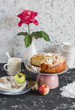 Homemade apple pie on a light background. Tea party table. Royalty Free Stock Image