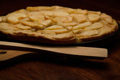 Homemade apple pie, and piece of pie with apple slices on cook board. Baking shovel lying near pie Stock Photography