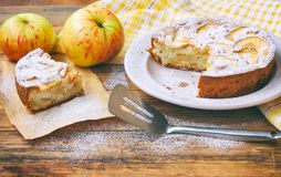 Homemade apple pie on plate dusted with icing sugar, piece of ca Royalty Free Stock Photos
